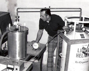 Meyer Tool founder Frank Meyer, performing a helium leak test on a custom vacuum chamber